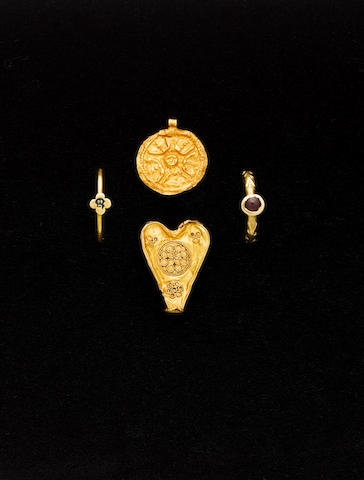 An Anglo-Saxon disc pendant  An Islamic gold heart-shaped fitting and two Medieval gold rings  4