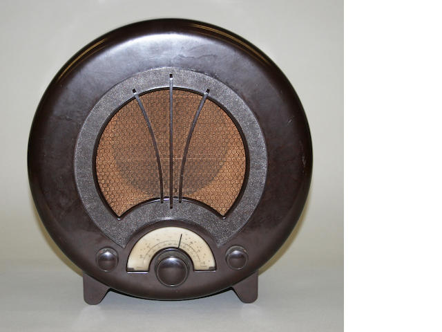 An Ecko type AD75 circular brown bakelite radio