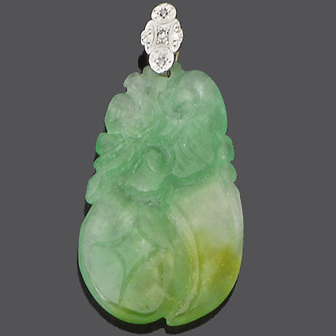 A jade and diamond pendant