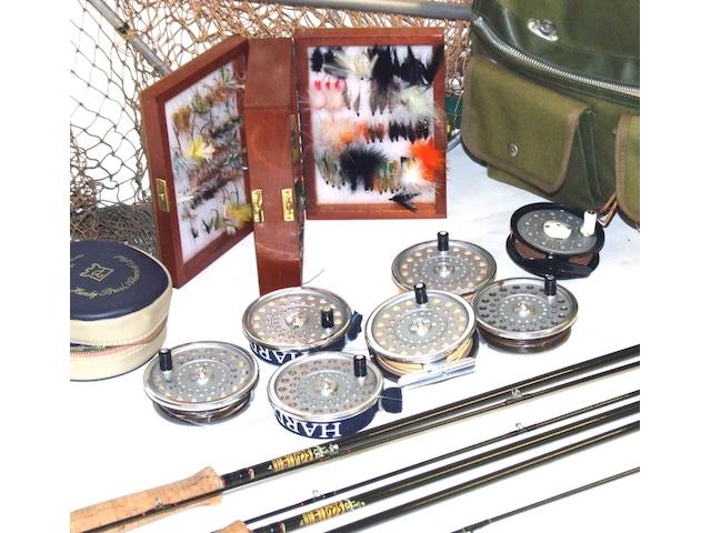 A Hardy carbon two piece fly rod 9ft 6in AFTM 6/7 in maker's blue cloth bag