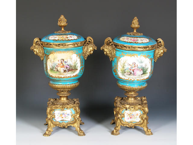 A pair of Sèvres-style ormolu mounted vases and covers