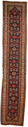 A Feraghan runner West Persia, 15 ft 10 in x 3 ft 3in (482 x 100 cm)