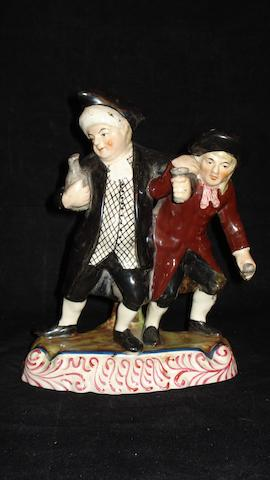 A Staffordshire figure group of The Vicar And Moses