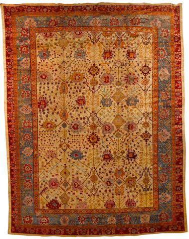 An Ushak carpet West Anatolia, 14 ft 6 in x 11 ft 3in (444 x 343 cm)