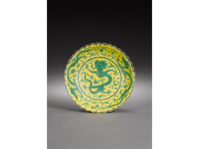 A yellow-ground green 'dragon' dish Qianlong six-character mark and of the period