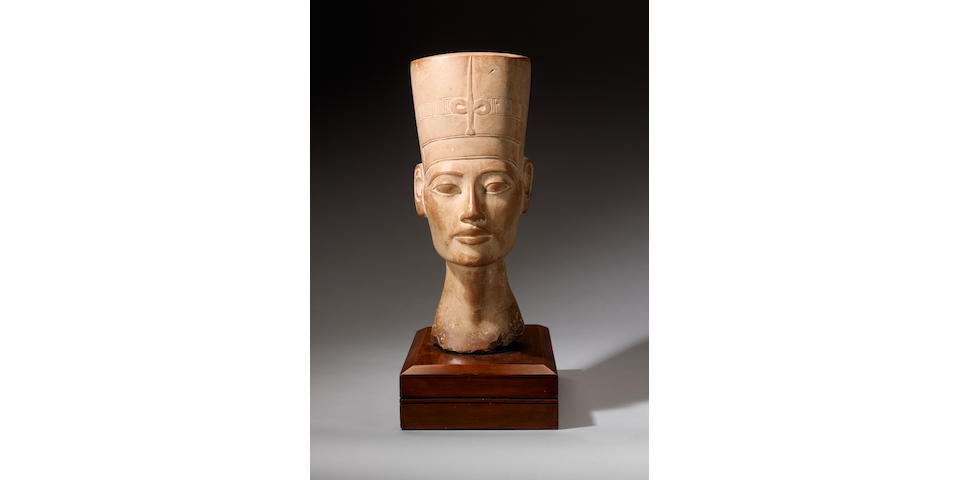 An Egyptian Revival carved stone head of Nefertiti