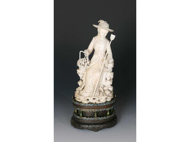 A 19th century Chinese carved ivory figure of a lady gardener