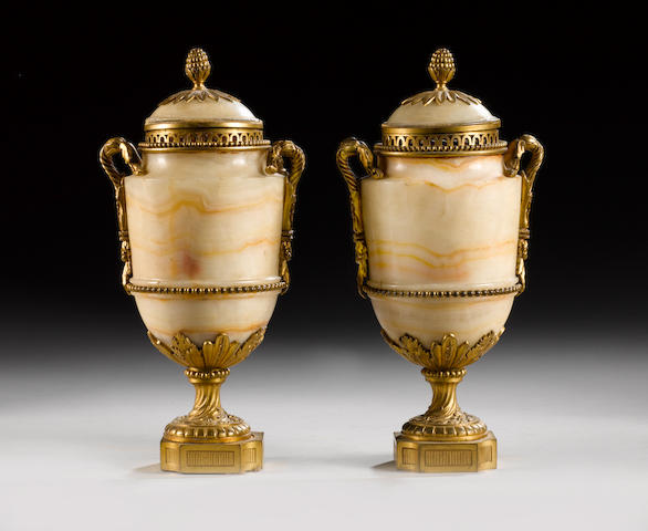 A pair of late 19th century French gilt bronze mounted cream onyx garniture Vases in the Louis XVI s