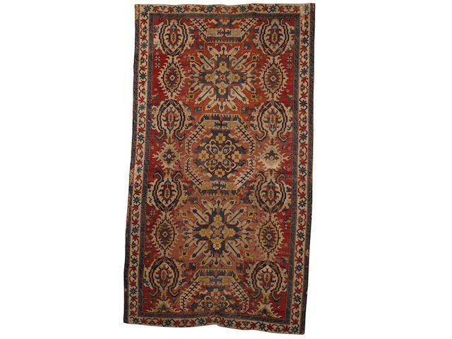 A late 18th early 19th century Karabagh carpet South Caucasus, 11 ft 11 in x 6 ft 6 in (363 x 198 cm),old restorations