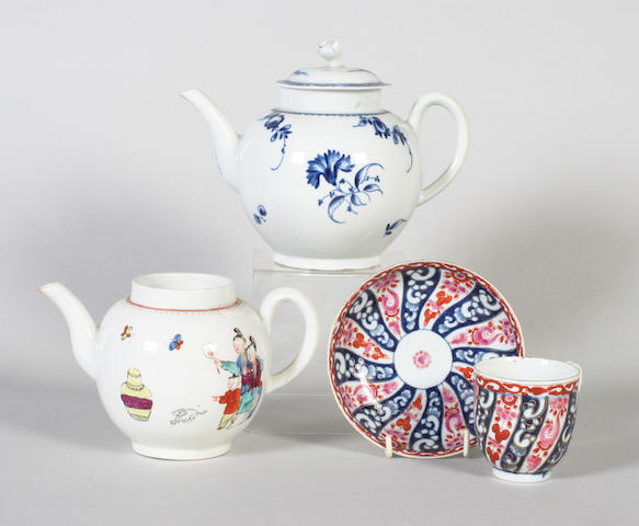A Worcester coffee cup and saucer, a Worcester teapot, and another Worcester teapot and odd cover