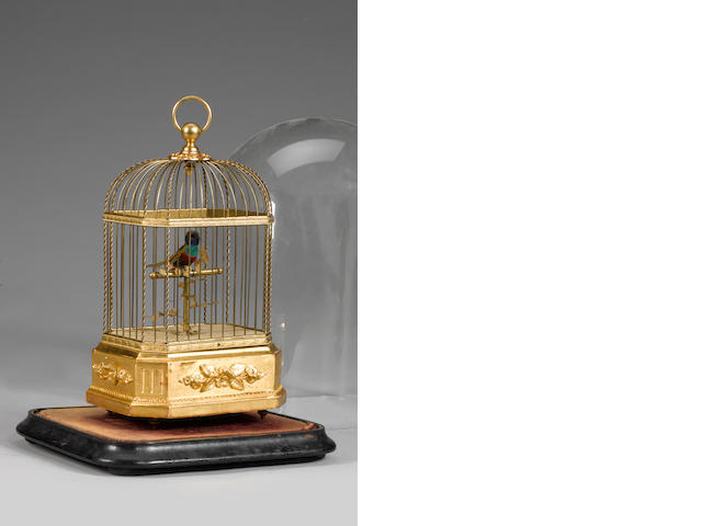A small singing bird-in-cage, late 19th Century