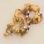 An 18ct gold sapphire and diamond brooch,