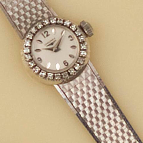 Longines: An 18ct white gold and diamond set lady's wristwatch