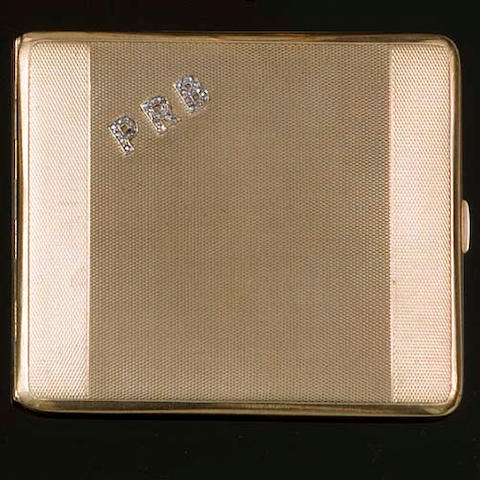 A 9ct gold rectangular engine-turned cigarette case