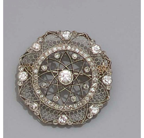An Edwardian circular diamond brooch