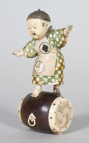 A Japanese ivory figure of a boy Meiji period