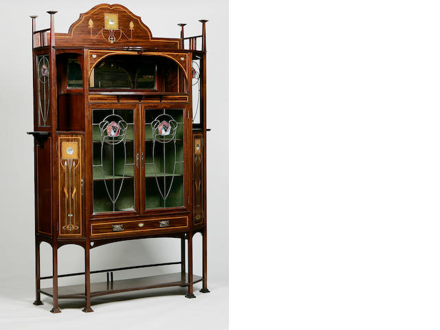 Atributed to E. A. Taylor for Wylie & Lochhead an inlaid mahogany and stained glass display cabinet