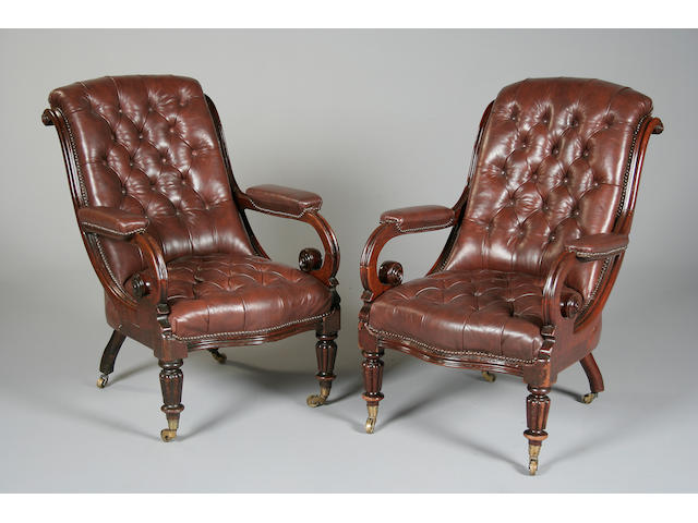 A pair of William IV leather upholstered mahogany armchairs