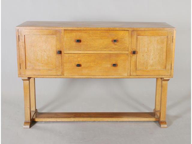 A Heal & Son oak dining room suite