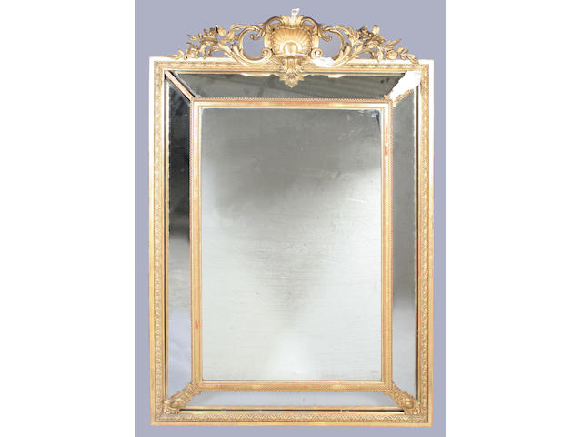 A late 19th century French gilt gesso framed overmantel mirror
