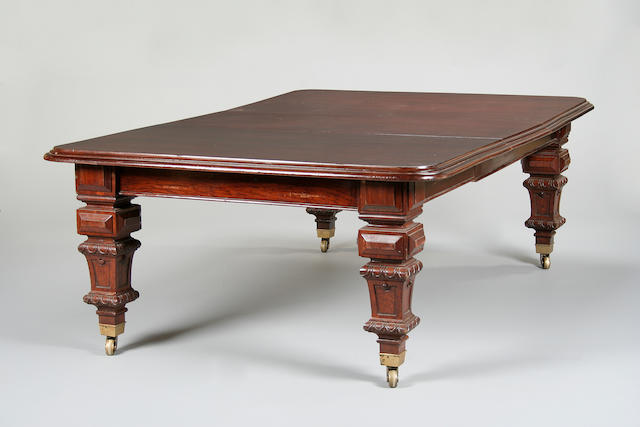 A large late Victorian   mahogany extending dining table