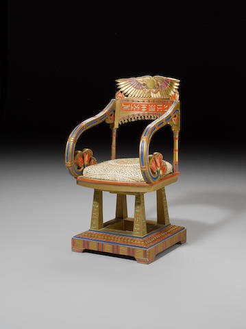 An Egyptian-style gold-painted and polychrome decorated throne 20th Century