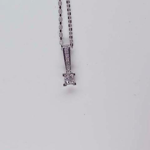 A diamond set pendant
