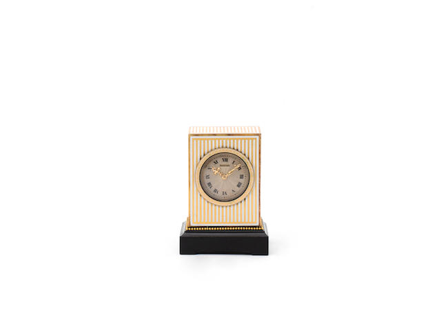 An early 20th century gilt and enamel miniature timepiece The case numbered 709 to the winding shutt