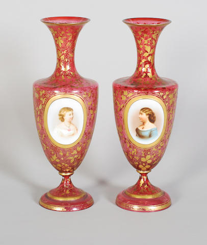 A pair of Bohemian ruby overlay glass vases