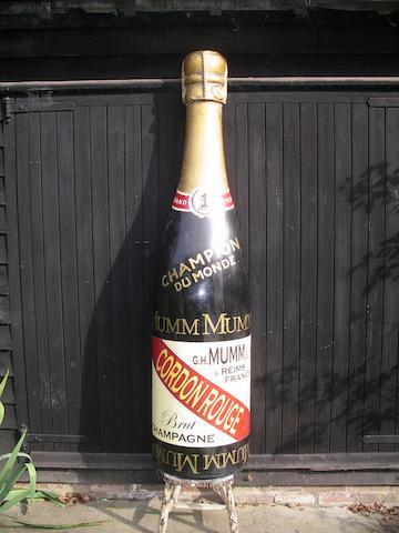 A fibreglass half Mumm champagne bottle,