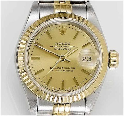 Rolex. A lady's stainless steel and gold centre seconds calendar bracelet watchDatejust, 1991