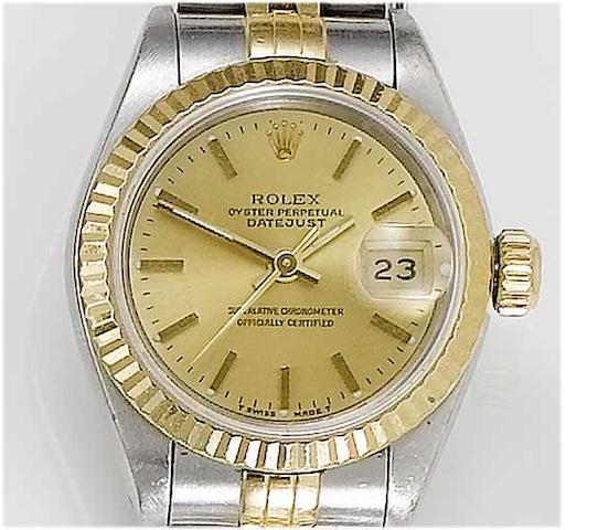 Rolex. A lady's stainless steel and gold centre seconds calendar bracelet watch  Datejust, 1991