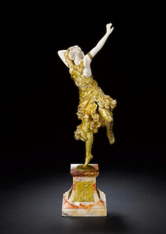 C.J.R. Colinet 'The Sun Dancer' a Fine Gilt Bronze and Carved Ivory Figure, circa 1920