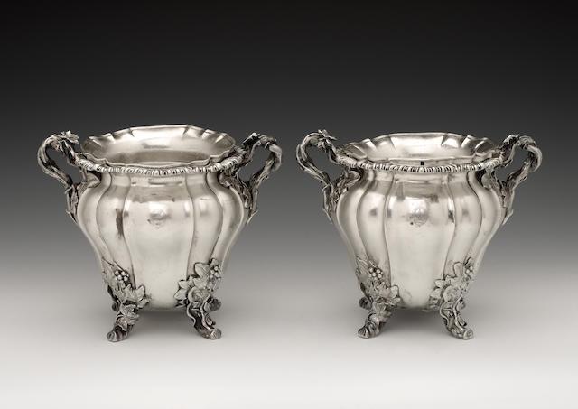 "A pair of George IV silver wine coolers, by Robert Garrard (II), London 1827, incuse stamped on base ""Garrards Panton Street London"",  (2)"