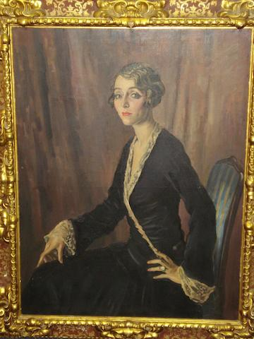 Alfred Neville Lewis (South African, 1895-1972) A portrait of the Duchess of Laurino, seated on a chair, circa 1930's, signed, oil on canvas, in a 19th century carved and painted giltwood frame, 108 x 82cm.