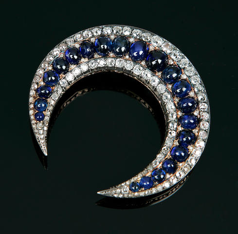 A large cabochon sapphire and diamond