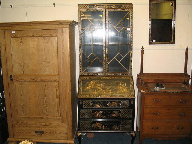 A mid 20th century black lacquered bureau bookcase