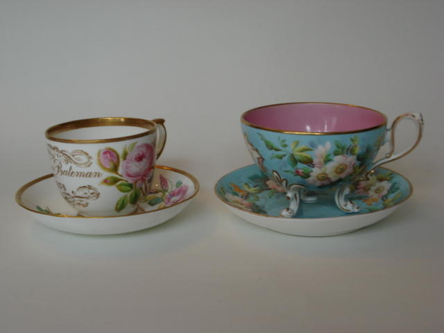 Four English porcelain inscribed cups and saucers