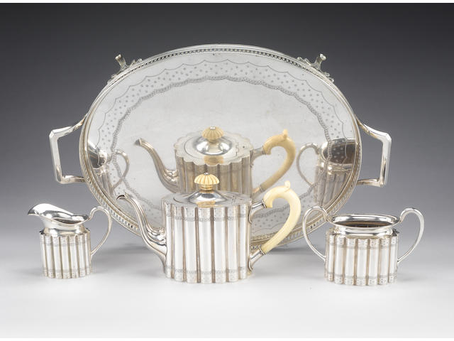 A late 19th century Austro-Hungarian silver three piece tea service with tray, Vienna, third standard mark,  (4)