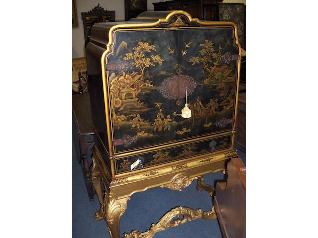 A 17th century style lacquered cabinet on stand