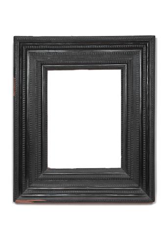 An Italian 17th Century ebony ripple moulding frame
