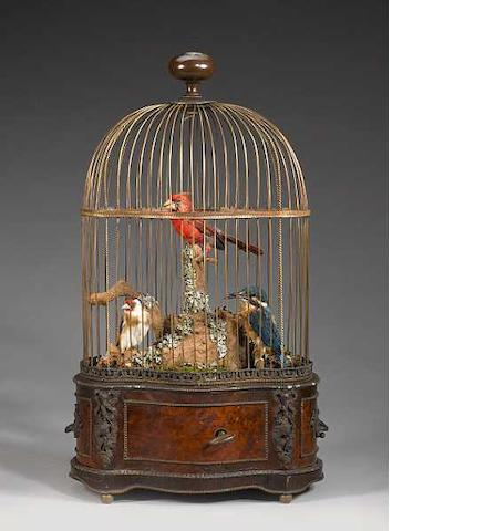 A singing bird-in-cage by Bontems, with two static birds,