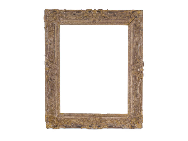 A Louis XV carved, pierced, and swept décapé frame
