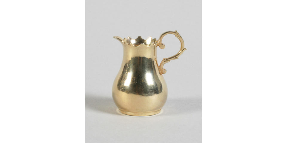A mid 18th century Dutch silver gilt miniature jug By Arnoldus van Geffen, Amsterdam, 1742,