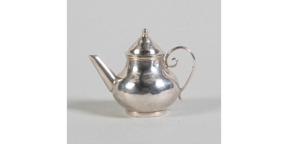 A first half of the 18th century silver miniature teapot By David Clayton, with maker's mark and lion passant only,
