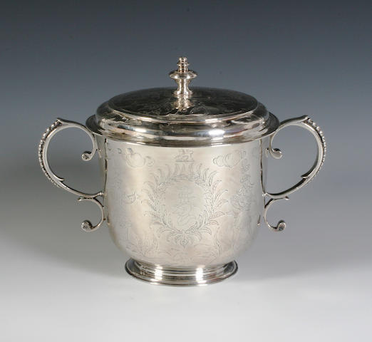 A William and Mary silver twin handled porringer and cover The porringer marked 'S.H' in a circular punch, 1689, the cover unmarked,