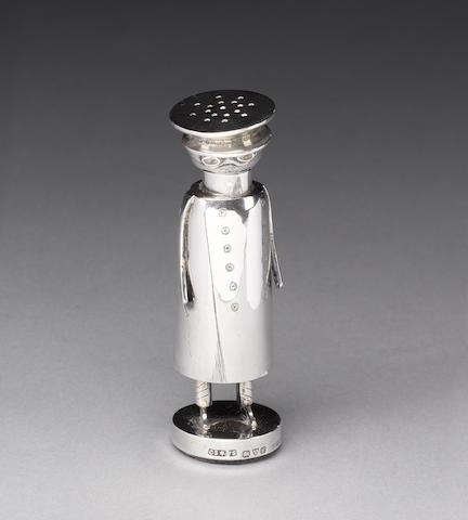 An Edwardian silver novelty pepper pot, by Saunders & Shepherd, Chester 1907,