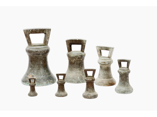 A set of seven George IV bell weights,
