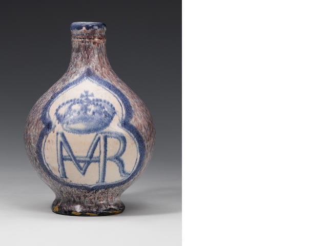 An unrecorded early English delft wine bottle bearing the cipher of Queen Henrietta Maria circa 1643