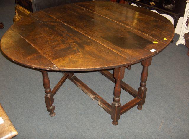 A late 17th century oak gatelegged dining table
